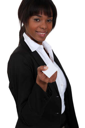 Smiling executive with a businesscard Stock Photo - 13343879