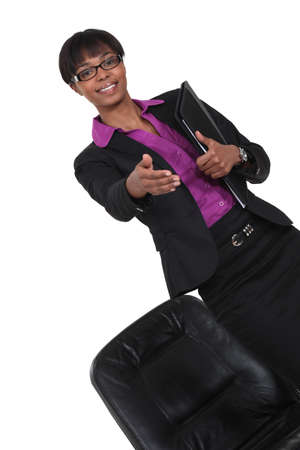successful black businesswoman stretches out her hand to shake hands photo