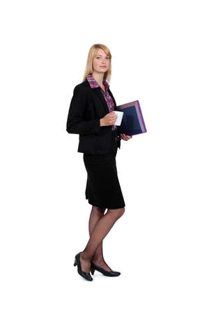 Woman with coffee cup and folders photo