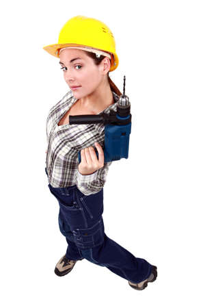 A female manual worker with a drill Stock Photo - 13343846
