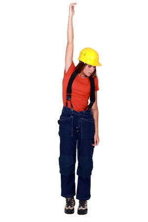 Tradeswoman being pulled up by an invisible object photo