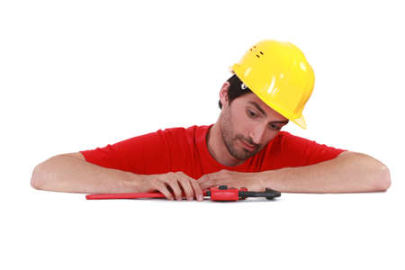 Man playing with a pipe wrench photo