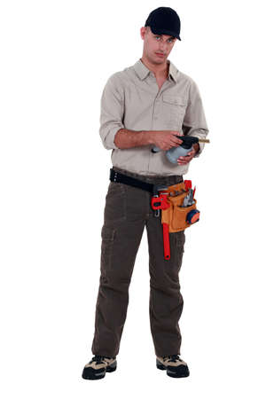 Plumber with blowtorch, studio shot photo