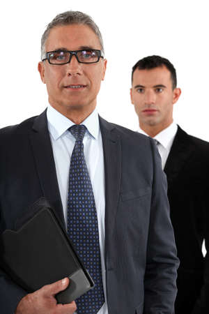 two visions: Businessman with young apprentice Stock Photo