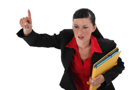 Angry businesswoman holding documents photo
