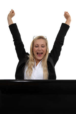 Excited blond businesswoman with laptop Stock Photo - 13344245