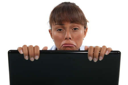 overly: Sad woman with a laptop computer
