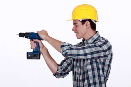 power operated: Tradesman holding a power tool Stock Photo