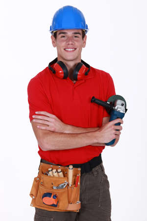 Young worker holding a sander Stock Photo - 13343913