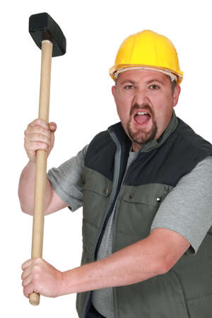 An angry tradesman holding a mallet photo