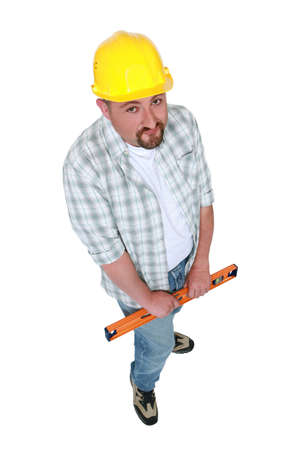 top angle view: Construction worker with a spirit level