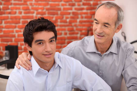 arms around: Man supporting his grandson Stock Photo