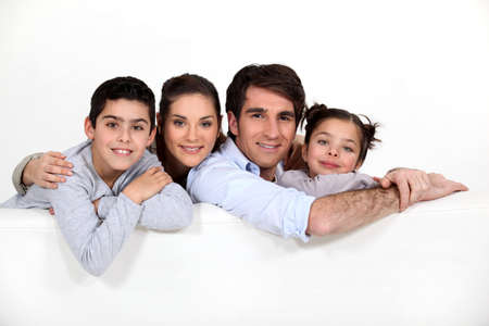 family unit: Family leaning on blank message board Stock Photo
