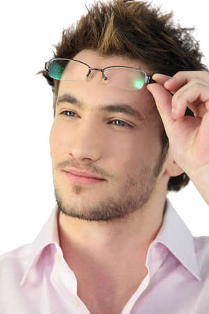 Portrait of young man wearing eyeglasses photo