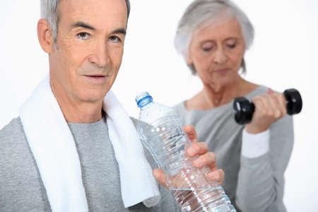 Senior couple in the gym photo
