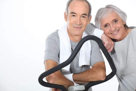 hale: senior couple doing exercises in the gym