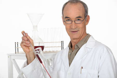 deduce: Scientist performing an experiment Stock Photo