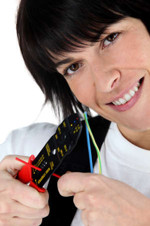 Woman cutting wire with special tool Stock Photo - 13379132