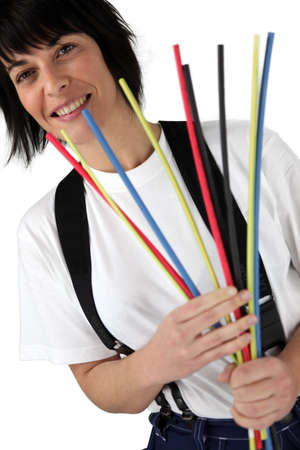 Woman holding pipe cleaners photo