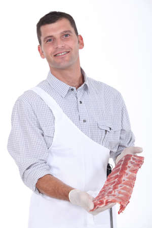giblets: a butcher showing pork ribs