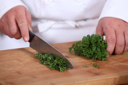 Chef chopping parsley photo