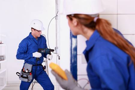 Workers renovating a kitchen Stock Photo - 13375511
