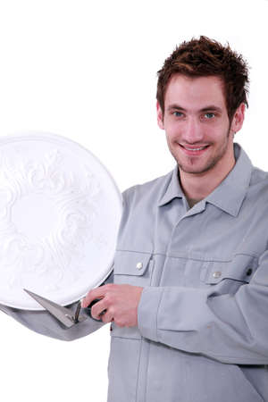 a craftsman with three days stubble showing his plaster moulding Stock Photo - 13380126