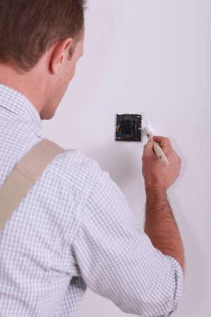 wall angle corner: painter retouching wall