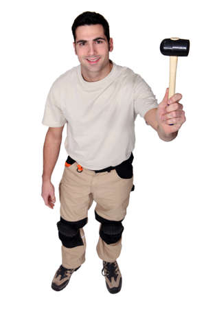 toolkit: Man holding rubber mallet