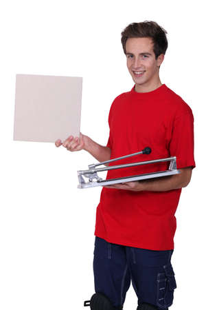 tile cutter: Man stood with tile cutter Stock Photo