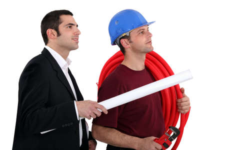 trustful: a plumber and a manager watching something Stock Photo
