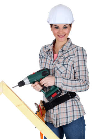 yourselfer: Woman drilling into plank of wood