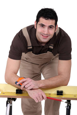 bent over: Man posing with his workbench