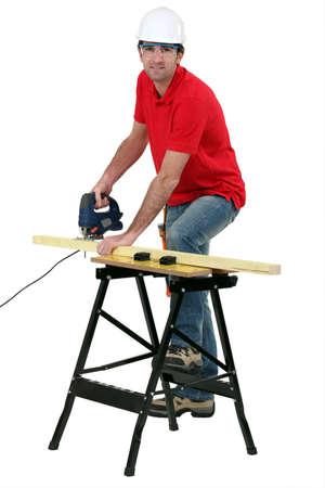 Cabinetmaker cutting wood photo