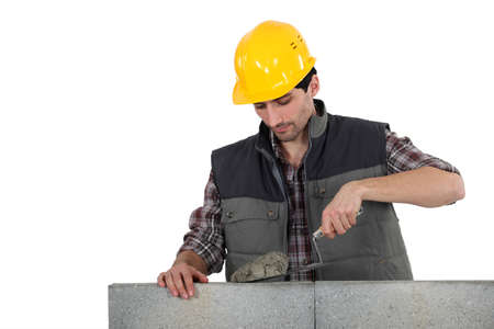 constructors: Man with trowel and cement