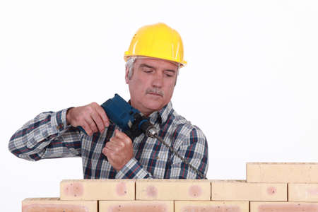 Tradesman using a screwdriver photo