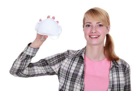 Woman holding a face mask photo