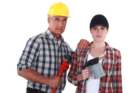 Tradespeople holding tools Stock Photo - 13380050