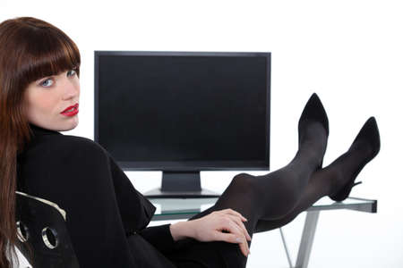 stockings feet: Woman in office with her feet on the table