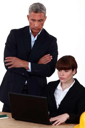secretary desk: director examining the work of an employee
