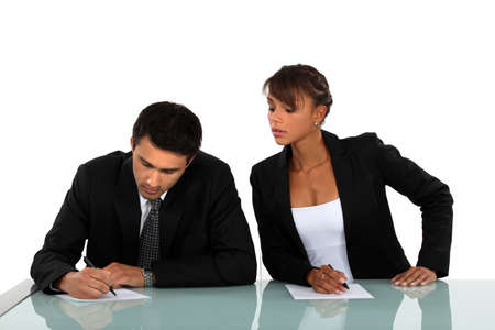 cheating woman: Woman copying on her workmate