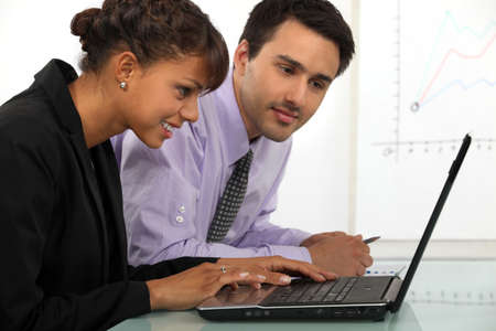 affiliation: young businessman and businesswoman working together