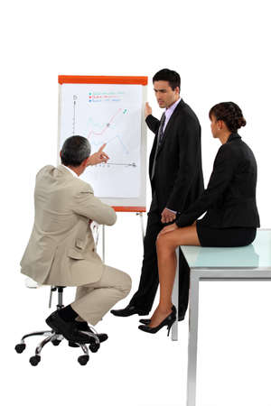 office environment: Three employees in business meeting Stock Photo