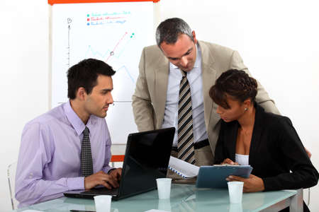 A team of business professionals working together Stock Photo - 13379819