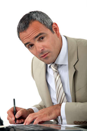 verifying: Attentive businessman making notes