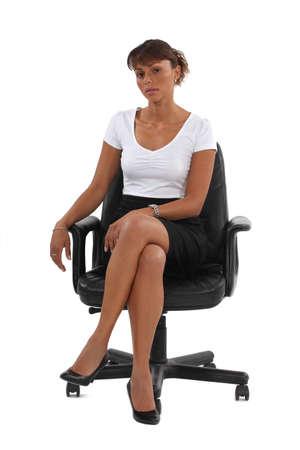 high heels: Businesswoman sat in office chair