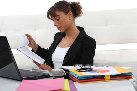 swamped: Woman swamped with paperwork