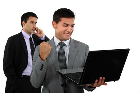 Successful businessman with laptop photo