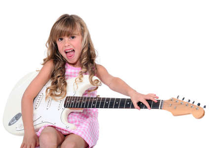 Girl with ringlets and guitar Stock Photo - 13378963