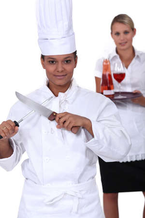 chef and waitress posing together photo